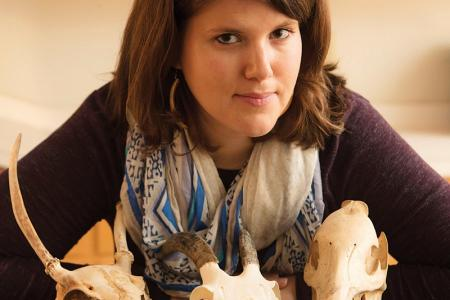 Suzanne Pilaaar Birch, faculty in both anthropology and geology, with animal skulls from a research collection.